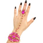 Gold metal hinge hand chain bracelet with fuchsia stones. Stretch ring
